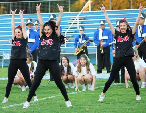 Senior cheerleaders Rose McAnally, Janice Hanson and Lexi Peters perform their ACDC number at the pep rally Oct 21.