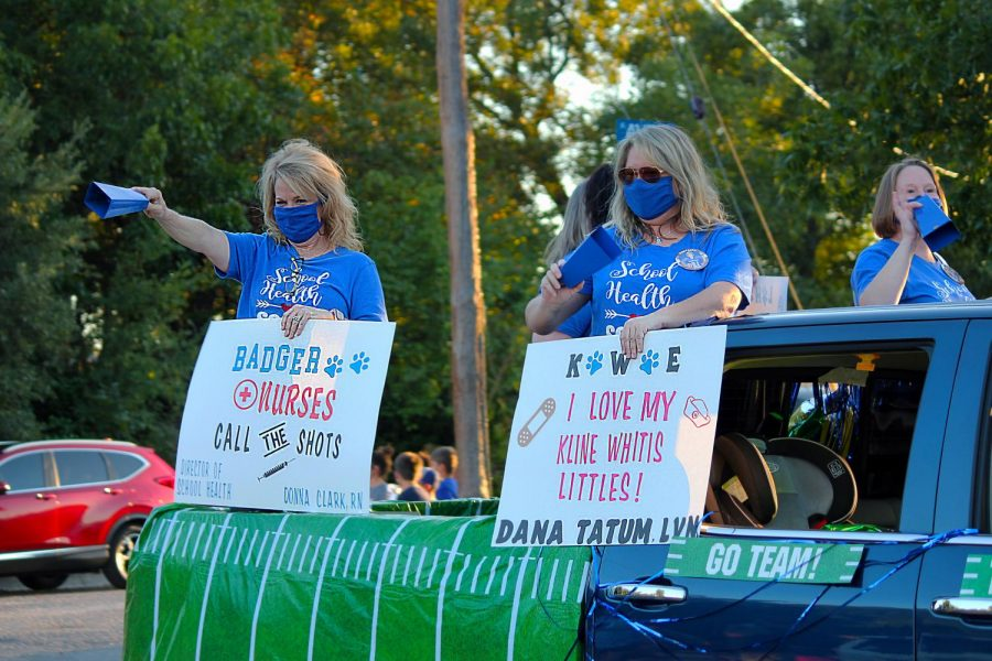 District nurse Donna Clark and Kline Whitis Elementary nurse Dana Tatum ride in the homecoming parade Oct 21.