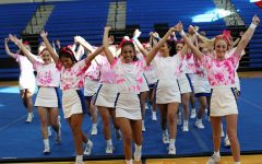 Cheerleaders perform during the filming of the Pink Out pep rally Oct. 15. The Pink Out pep rally will be shown during academic period Oct. 23.