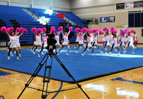 "The cheerleaders perform in front of the camera for the virtual ""Pink Out"" pep rally. Students watched this pep rally during academic period Oct. 23."