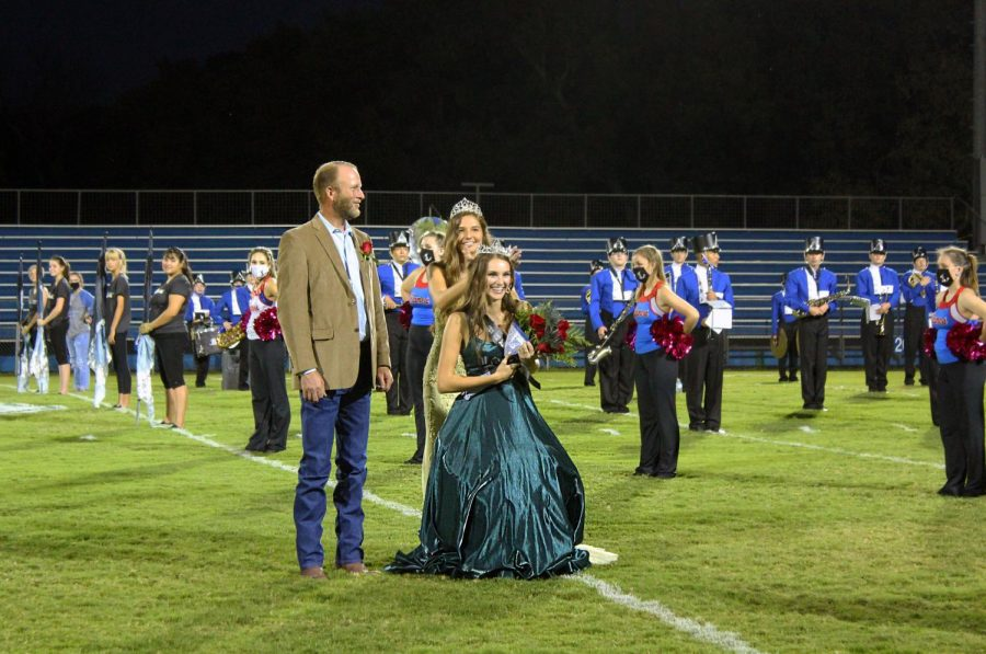 Senior Addison McDonald is crowned 2020 homecoming queen by 2019 homecoming queen Jessica Ball.