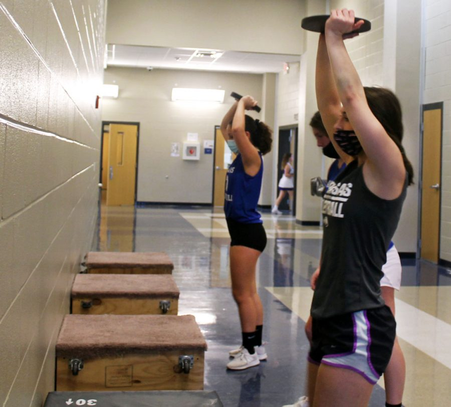 The volleyball team does weight training Sept. 30.