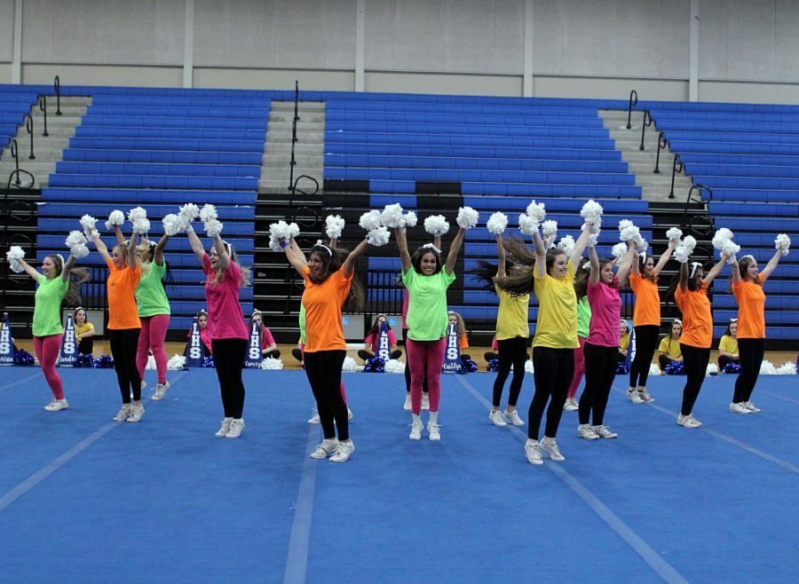 The cheerleaders perform in a triangle formation.