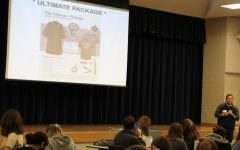 A Herff Jones representative speaks to the senior class about placing their cap and gown orders Nov. 4.