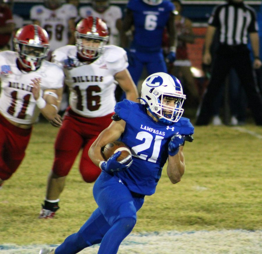 Sophomore Ethan Moreno returns a kick at the district championship game against Fredericksburg Nov. 6.
