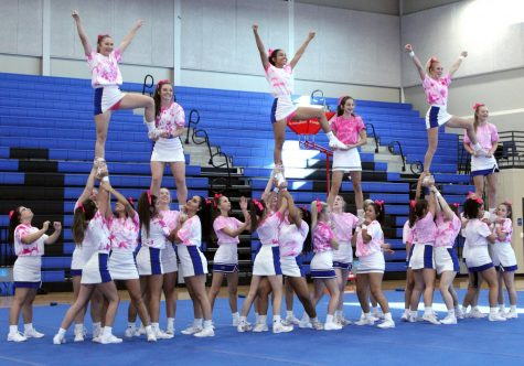 "The cheerleaders record their performance for the ""Pink Out"" pep rally."
