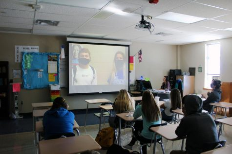 English II teacher Jen Moore watches the Veteran's Day video with her academic period Nov. 4.