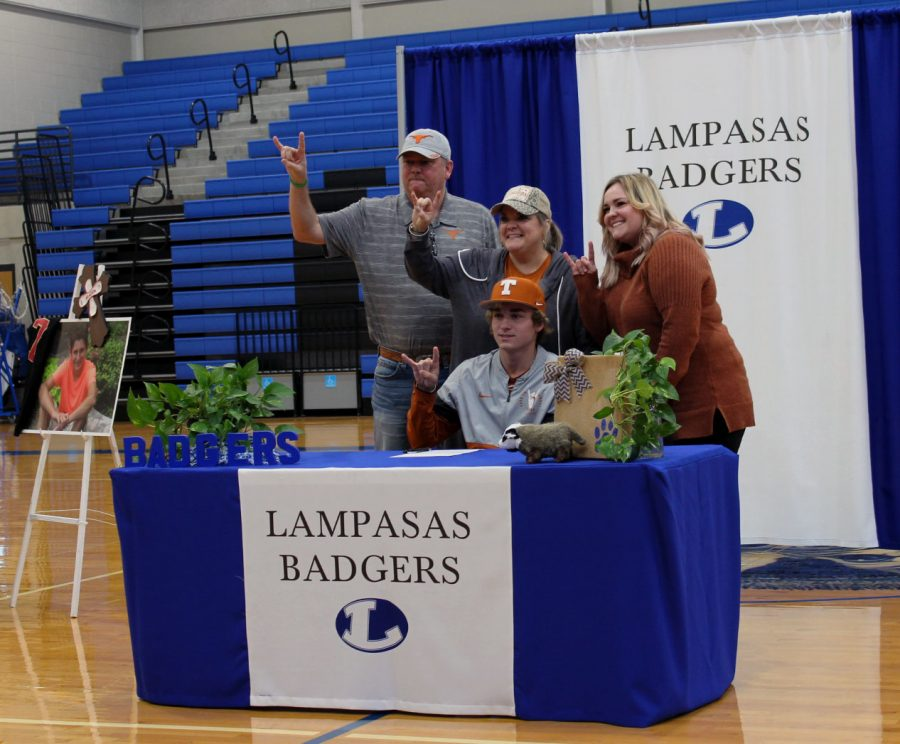 Senior Ace Whitehead and his family celebrate after Whitehead signed his National Letter of Intent to play baseball at The University of Texas Nov. 16.