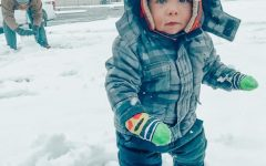 Coach Tanner McLean's 1-year-old son Tripp plays in the snow  Jan. 10.