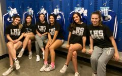 Cheerleaders receive new uniforms before heading to UIL State.  They will compete in-person for the first time this school year.