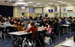 Freshmen eat in the cafeteria alongside upperclassmen for the first time Tuesday. They had been eating in the gym to social distance.