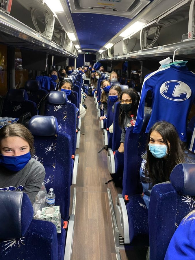 The cheerleaders ride a charter bus for their first in-person competition of the year at UIL State in the Fort Worth Convention Center Jan. 15.