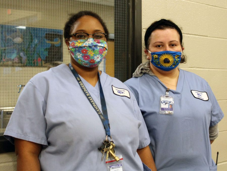 Linda Nix-Byrd and Martha Munoz are two members of the custodial staff who work during student lunches. Custodians have had to work extra hard over the past year due to COVID.