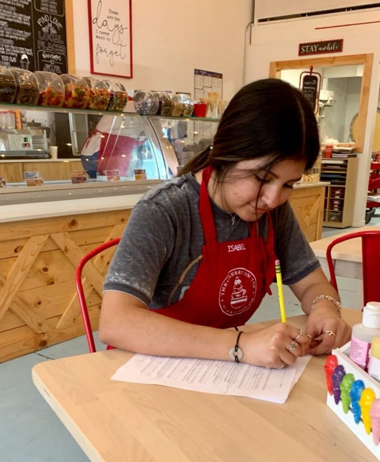 Virtual junior Isabel Ybarra completes school work while working at The Cherry on Top.