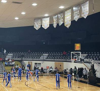 The basketball team warms up before the Area game against Argyle Feb. 25.
