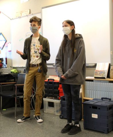 Juniors Daniel Rounds and Karli Robertson wear masks while giving a persuasive presentation in Dondi Hinds English class March 9.