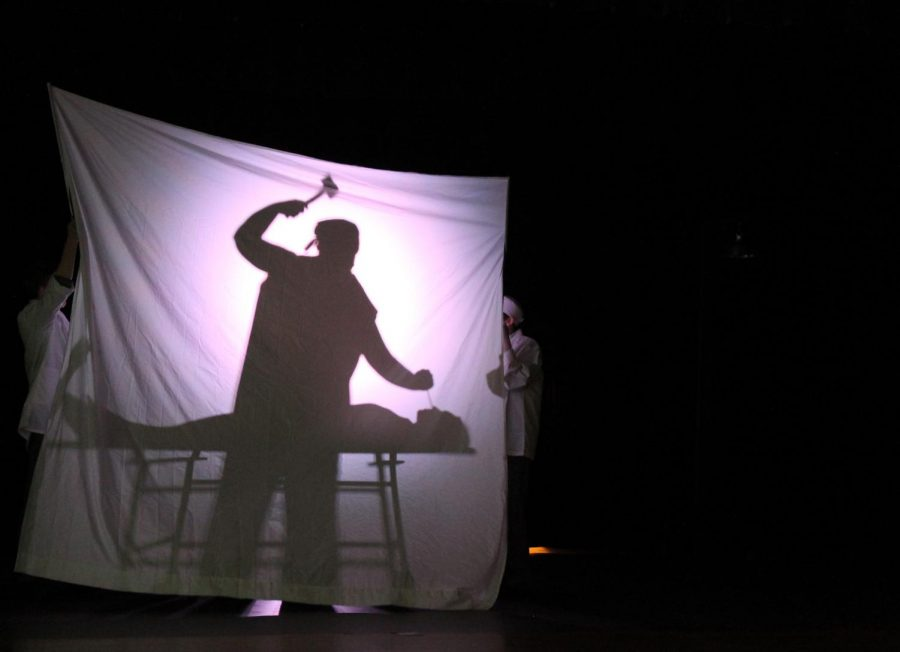 Junior Michael Neary, as his character Dr. Freeman, acts out a lobotomy on Abby Taylor in the role of Frances Farmer during their performance of