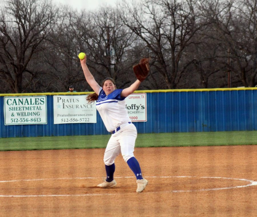 Junior Caitlin Sanguinet pitches against the Gatesville Hornets in the district home opener March 23.