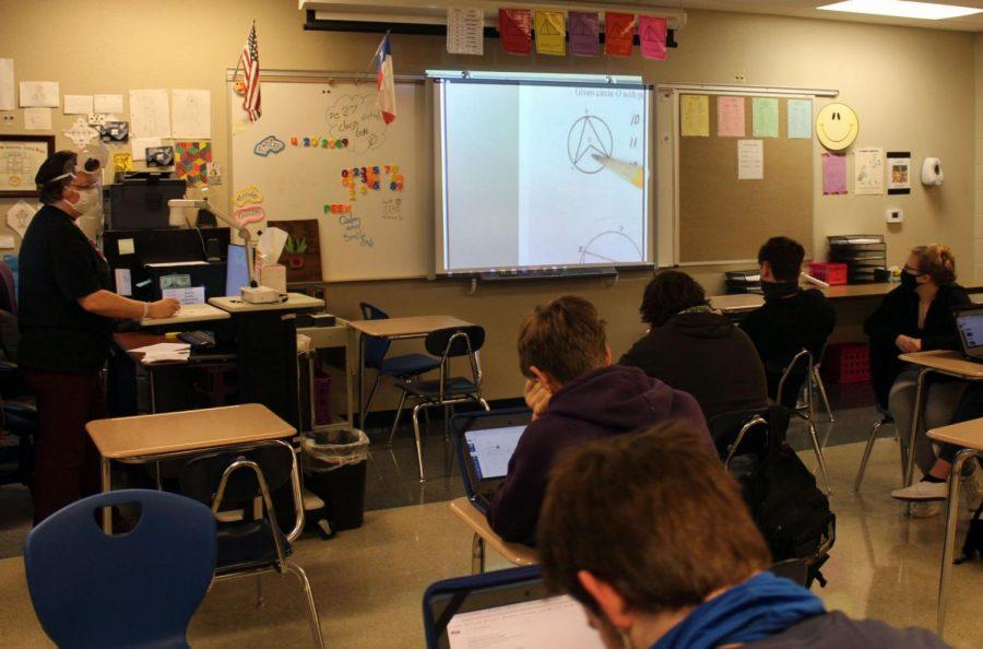 Math teacher Patricia Bird teaches her second period class April 23.