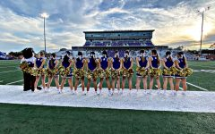 Cheerleaders stand  on the sidelines during the 2020 football season.