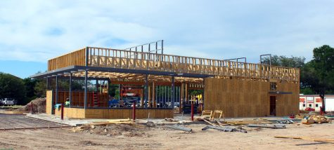 Construction workers build the Whataburger establishment May 7.