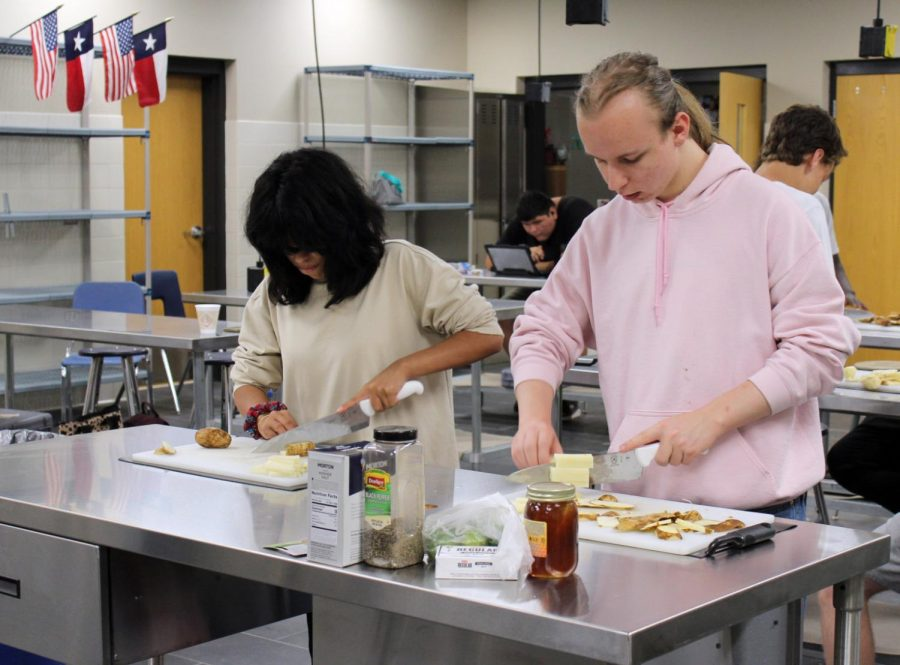 Juniors Layla Lightfoot and Dylan Shotwell make french fries during 9th period culinary arts class Aug. 24.