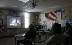 U.S. Government teacher Justin Schulze shows 9/11 videos to his class to help them understand the peoples point of view.