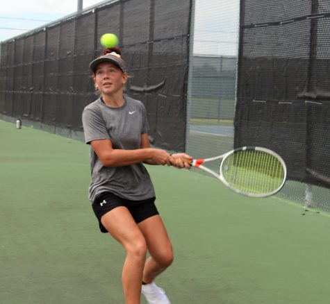 Sophomore Allison Valdez practices tennis after school Aug. 18.