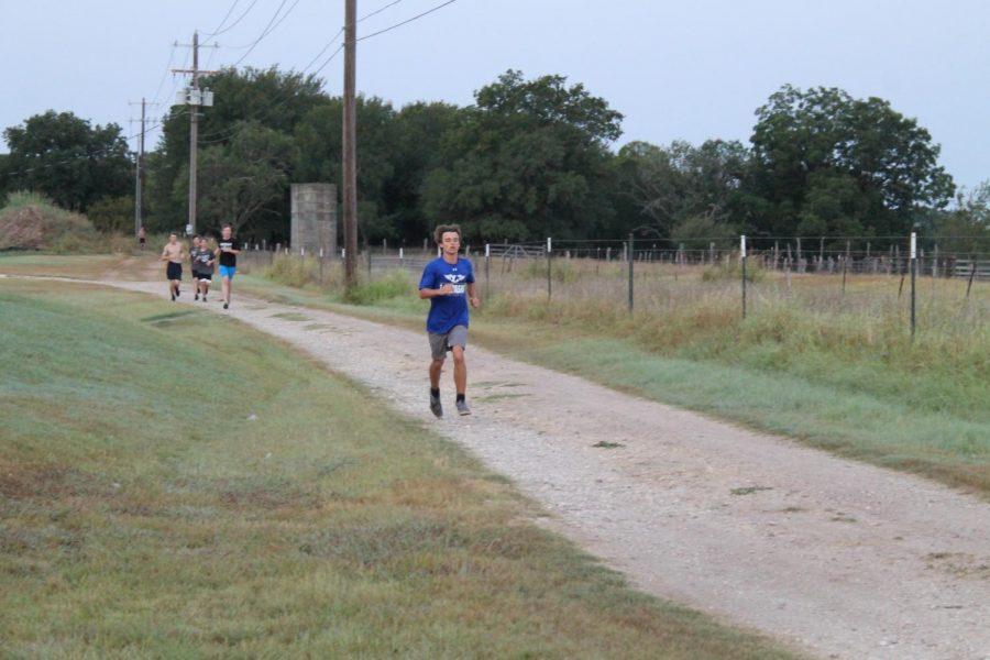 Sophomore Wilson Hammond runs during cross country practice before school.