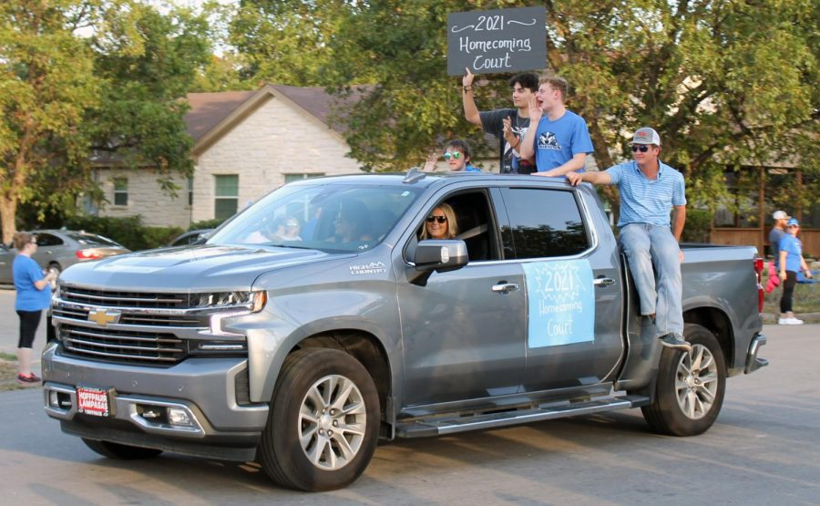 Homecoming king nominees Collin Martin, Dylan Jones, Quinn Pace and Jaxon Tomme ride in a float during the homecoming parade Sept. 15.