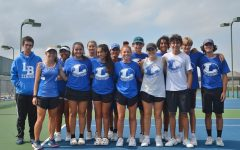 The tennis team celebrates their Bi District victory against Decatur Tuesday.
