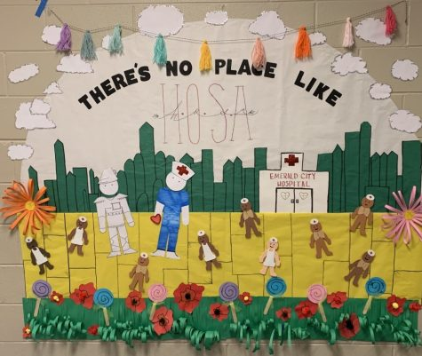 HOSA sponsor Christie Fords  door won first place in the Theres No Place Like HOMEcoming door decorating contest with this HOSA theme.