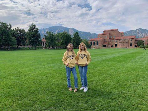 Seniors Kayla McManus and Lexi Moreland pose on the main field at Colorado University.