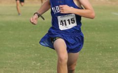 Sophomore Kaleb Roberts crosses the finish line at the cross country meet Sept. 30.