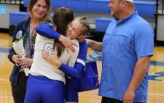 Seniors Hadley Oncken and Kayli Syx embrace at volleyball Senior Night Oct. 12.
